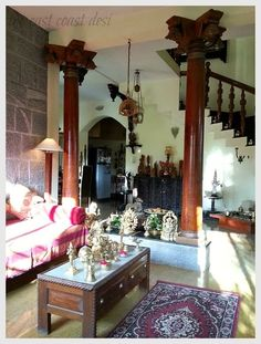 The antique pillars have been incorporated in such a way so as to create an open floor plan but at the same time create a distinct area for the formal living room #Padminihouse