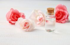 roses around bottle of rose water