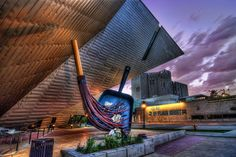 DAM  Denver Art Museum at sunset. Cool building with cool sculptures around the…