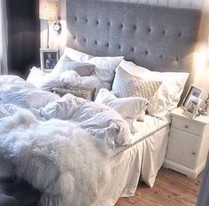 Grey headboard and LOTS of different textures incorporated in bedding. Love this idea for my master bedroom!