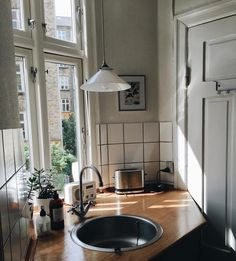 kind of a weird kitchen corner but I like the idea of a window by the sink and a light over it.