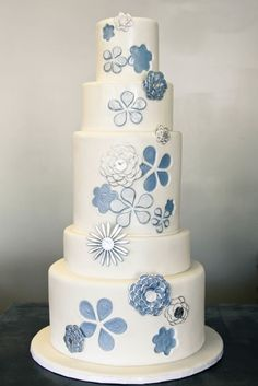 This cake is so fun and pretty. The denim blue and the way the flowers are embossed, 3D, metallic...so great.