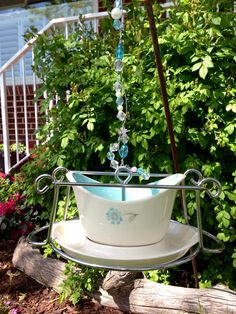 """Sold.. """"Vintage Gravy Boat"""" Bird Feeder, made from vintage gravy boat and placed on an casserole stand turned upside down, this gives the birds lots of places to perch at the feeder. Great colors with lots of Bling !  I can make you something like it :)  SOLD ... Thank you"""
