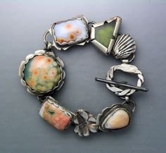 Bracelet | Temi Kucinski.  Sterling silver, ocean jaspers, and a fossil coral cabochon