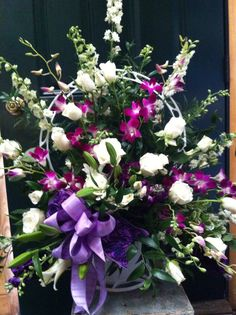 Orchid and roses funeral basket