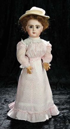 """22""""~French Bisque Bebe with Original Lady Body by Emile Jumeau~~French composition and wooden fully-jointed lady body with shapely bosom and tiny waist. Marks: Depose Tete Jumeau Bte SGDG 9 (head) Bebe Jumeau Diplome d'honneur (body). Comments: Emile Jumeau, circa 1890. Value Points: lovely face with fine creamy bisque, beautiful eyes, rare lady body, antique lady gown."""