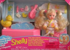 "Barbie SHELLY (Kelly) Bathtime Fun Doll Set - Shelly Splashes In Her Bubbling Bath! (1995) by Mattel. $49.99. Bathtime Fun Shelly Doll, Baby Sister of Barbie! is a 1995 Mattel production playset. Model #14552. Box is multi lingual w/English, Spanish, French and more. Contents include: Shelly doll that's approx. 4.5"" tall with long blond pigtails. Shelly wears a white Bath Robe w/yellow Ducks outlined in pink & pink dots pattern; Bath Robe has Belt at waist. Shelly comes with ..."