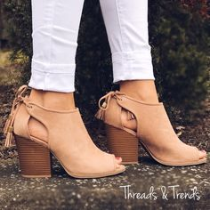 "Stunning taupe color peep toe sandal booties with tassel tie closure detail.  Trendy stacked chunky heel. Get the spring/summer look in these beauties. Price is firm unless bundled.                                                                                     Heel Height: 3.5"" (approx)  Shaft Length: 6.25"" (including heel)  Top Opening Circumference: 11"" (approx)"