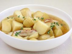 Get Slow Cooked Potatoes with Butter and Thyme Recipe from Food Network