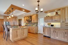Beautiful Open Kitchen With Quartz Counter Tops Hickory Cabinets Birch