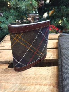 The Barbour Steel Hipflask is desgined with Barbour's classic tartan and makes a perfect Christmas gift