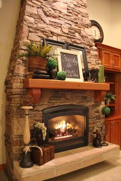 I love this fireplace & the way it is decorated also