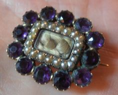 PRETTY GEORGIAN MOURNING BROOCH SEED PEARLS PLAITED HAIR & PURPLE STONES   eBay, sold for £85.62