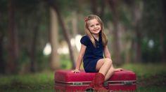 Humor Girl Sitting on Suitcase