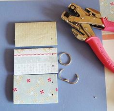 DIY make a mini scrapbook out of toilet paper rolls.