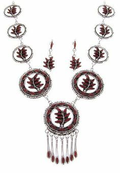 """Native American Coral Link Necklace Earrings Set GS57607 SilverTribe. $549.99. MEASUREMENTS: Necklace measures approximately 27-3/4"""" inside circumference, allowing the smallest side link to measure approximately 1"""" long (excluding side rings) and 1"""" wide, each larger side link measures approximately 1-3/8"""" long (excluding side rings) and 1-3/8"""" wide, while the center link measures approximately 2-3/8"""" long (excluding side rings) and 1-3/8"""" at widest point. The earrings me..."""