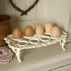 I love collecting and selling antiques. Almost everyday I see something I've never seen before - a cast iron egg holder.