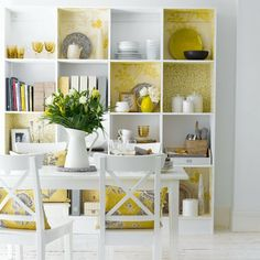 love the backs of these shelving units in the different colors and patterns