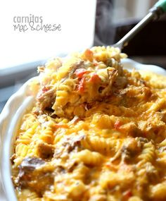 Carnitas Mac and Cheese...simple Slow Cooker Carnitas mixed in to a creamy cheesy Mac and Cheese!