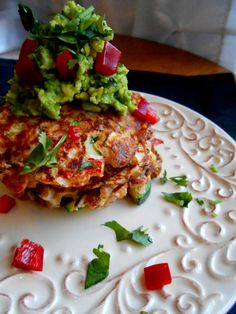 Mexican Skillet Cakes stacked high with a dollop of guacamole to finish.  Sub flax seed for eggs, instant Vegan.