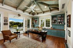 Wood bookcase/storage, exposed beams, great chair in this British Colonial Study ~T.
