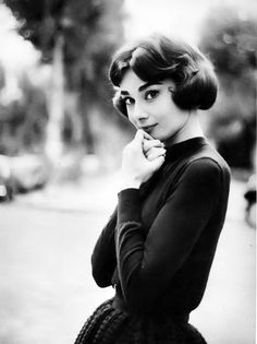 Audrey Hepburn photographed by Sam Shaw, Paris, France, 1957.