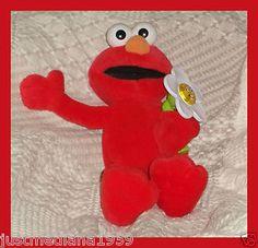 Fisher Price Sesame Street Stuffed Elmo Loves You Talking Light Up Flower Doll