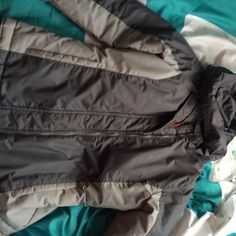 Stylish kid jacket pretty Dark grey and light grey on the outside. Bright pink on the inside same color exactly as the ROXY snow pants. Worn but still I'm good condition no stains or tears.comfy and very warm Old Navy Jackets & Coats