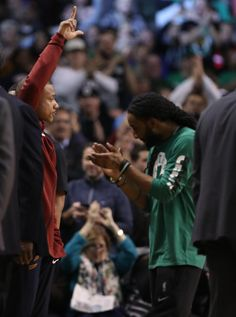 Isaiah Thomas (left) responded to cheers when fans spotted him on the Garden scoreboard.