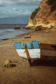 Old row boat on an empty beach