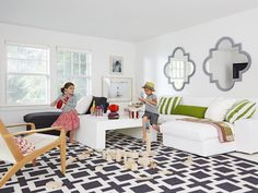 play room - Decorated by Mom With Love on HGTV--need to rethink the basement, do I dare paint some of that wood white.or wood the wood gods strike me down with a bolt of lightning (and by wood gods I mean my stepdad). Kid Spaces, Living Spaces, Living Room, Colorful Playroom, Playroom Ideas, Ikea Sectional, Comfortable Pillows, Family Room Decorating, Cool Rooms