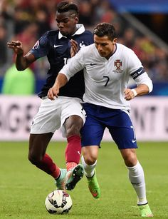 Cristiano Ronaldo of Portugal vies for the ball with Paul Pogba of France God Of Football, Football Soccer, Paul Pogba, Portugal Soccer, Cristiano Ronaldo 7, International Football, Sport Inspiration, Sports Images, Best Player