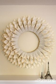DIY paper wreath - Want to add a little vintage vibe to your home? An old book, hot glue gun and simple wreath form are all that you need to create a beautiful paper wreath that can be used all year-round.