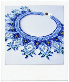 XOCHIL CARIBE Mexican Huichol Hand-Beaded Tribal Collar Necklace with Silver Clasp. $125.00, via Etsy.