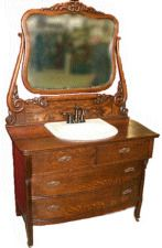 Antique dresser converted into a bathroom vanity.    This is how I will be doing my bathroom vanity. I am purchasing an antique dresser very similar to this one and converting it. I am planning on staining it black with an oil based stain or painting it an antique white to update the look.