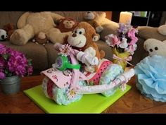 In this video Thom shows you how to make a simple Tricycle Diaper cake. A fun new way to make a Diaper Cake for your Friends or Family. Surprise them at the next Baby shower with a special gift.    Baby Shower - Diaper Cake - Baby Gift - Party Gift - Tricycle Diaper Cake