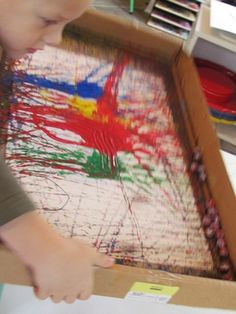 Painting with marbles. My nephews would enjoy this.
