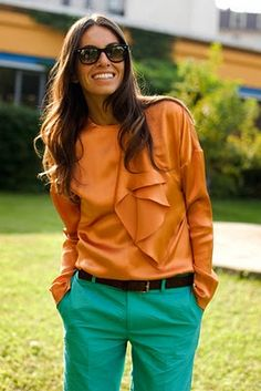 orange top green pants