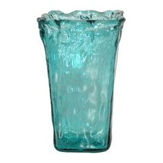 """Brimming with warmly weathered appeal and a dash of cottage-chic style, this lovely accent offers on-trend style to your foyer, living room, or master suite dcor.  Product: VaseColor: TurquoiseDimensions: 9"""" H x 5.5"""" W x 5.5"""" D"""