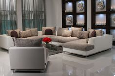 Two tone beautiful sofa where contemporary meets comfort. The Hanna collection features many configurations and possibilities ready to fit your needs. Generous seating upholstered in a dark gray fabric blend for durability over a white faux leather upholstered frame with a chrome metal base. Assorted pillows included as shown.