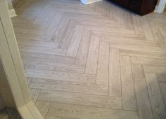 Wood looking tile on bathroom floor. Interceramic, Scenic in color Coastal White