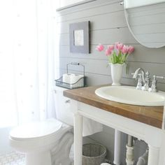 Farmhouse bathroom style. Love the look. Storage is lacking but it's beautiful