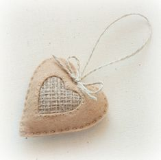 Set of 4 hand sewn Felt Hearts Holiday Ornaments. Each comes with a natural jute rope attached so you can hang them anywhere. The hearts looks well in any interior. Perfect as favors or to include in a bag of gifts to your lover or friend. Could be for Valentines Day, for Christmas or