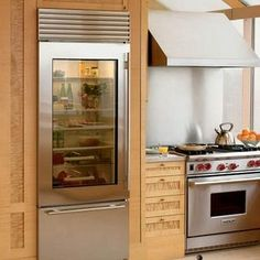 A glass-front refrigerator is a kitchen trend that is gaining popularity at a rapid pace. Just like the stainless steel kitchen countertop, the glass door Glass Front Refrigerator, Refrigerator Freezer, Subzero Refrigerator, Glass Fridge, Refrigerator Organization, Kitchen Refrigerator, See Through Refrigerator, Mini Fridge, Asian Kitchen