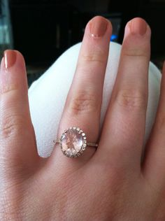 My beautiful engagement ring! Rose gold band with small inlayed diamonds around oval halo ring with light pink quartz stone.