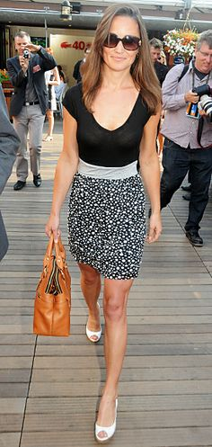 She attended the French Open in a black-and-white Zara dress, which she paired with peep-toe wedges and her leather Modalu handbag.
