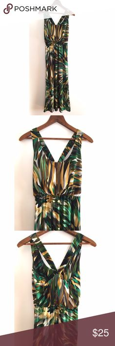 Beautiful tropical maxi dress ⭐️ Such beautiful colors! Worn once on vacation! Slip on, and cris-cross back. Flowy and light material, perfect for the hot weather! Excellent condition! boutique Dresses Maxi