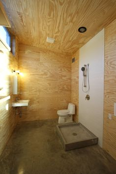 Plywood bathroom [Replace that one with a wall-hung toilet and this would be perfect! oh yea. . . and nicer tiles too.]