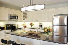 Bright, modern kitchen in a Port Hope model home. #geraniumhomes #newcondostouffville
