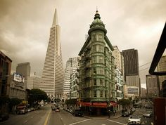 A view of the Columbus Tower in San Francisco, or Sentinel Building, with the famous Transamerica Pyramid in the background.